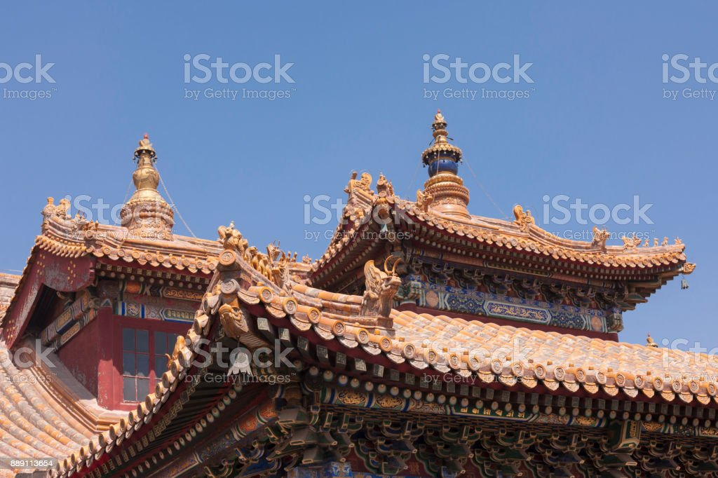 Decorated roofs with figures and wind-bells at Beijing Lama Temple stock photo