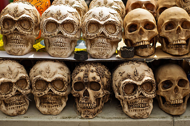 Decorated skulls at market, day of dead, Mexico stock photo
