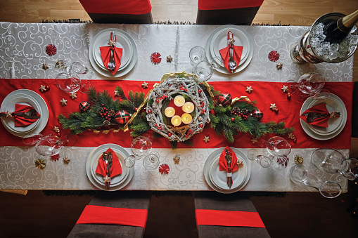 Decorated Table for Christmas Dinner with Candles and Christmas Ornaments