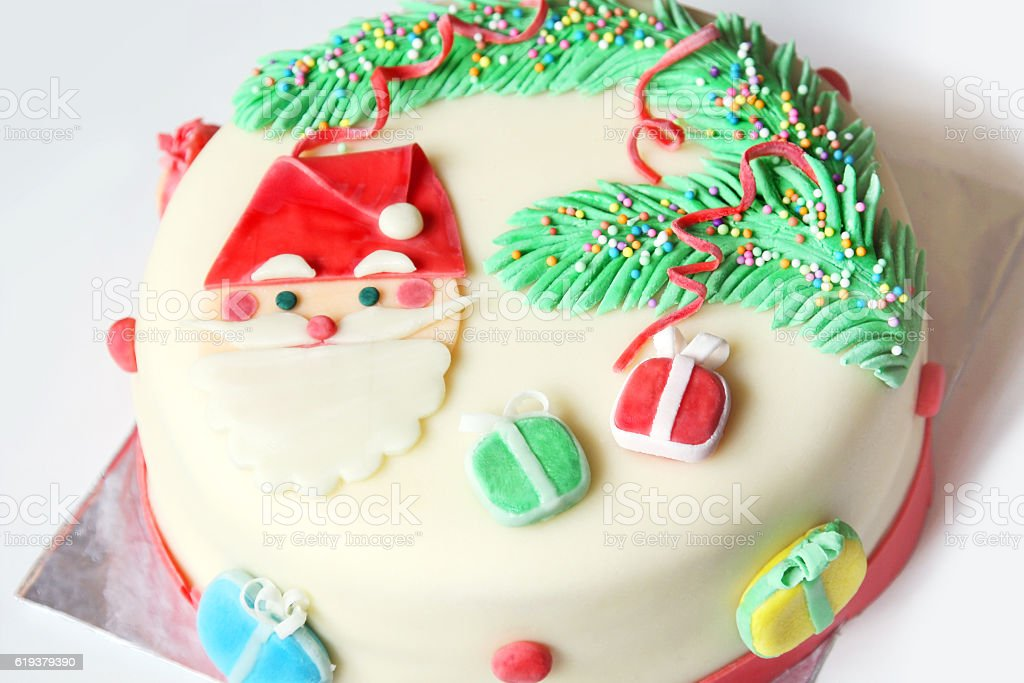decorated with sugar paste christmas cake: santa, christmas tree and gifts stock photo