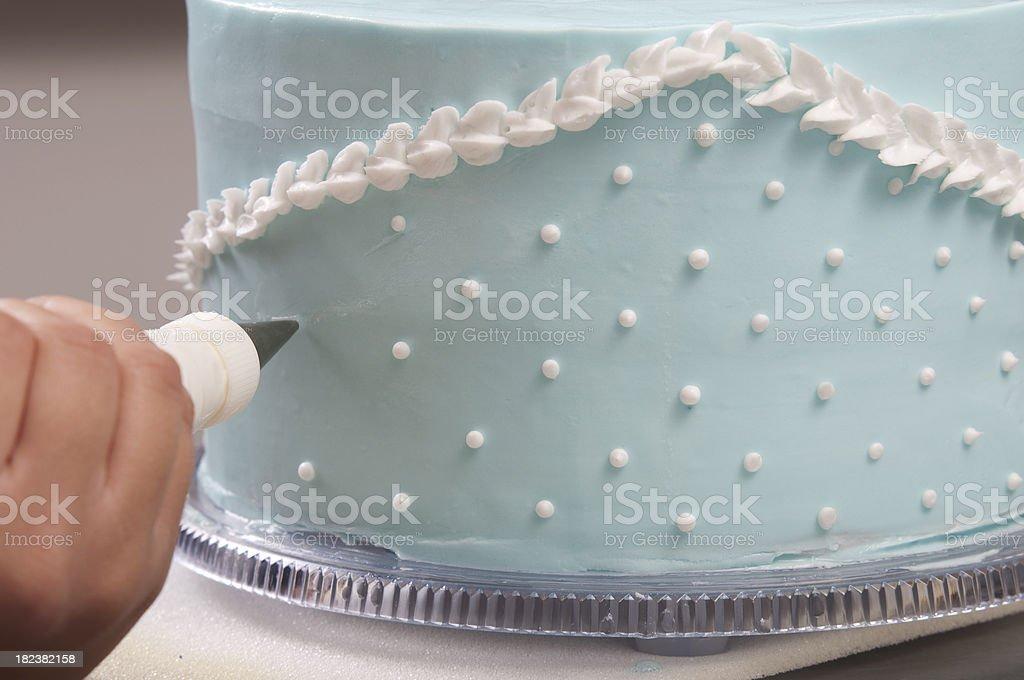 Decorating a blue wedding cake stock photo