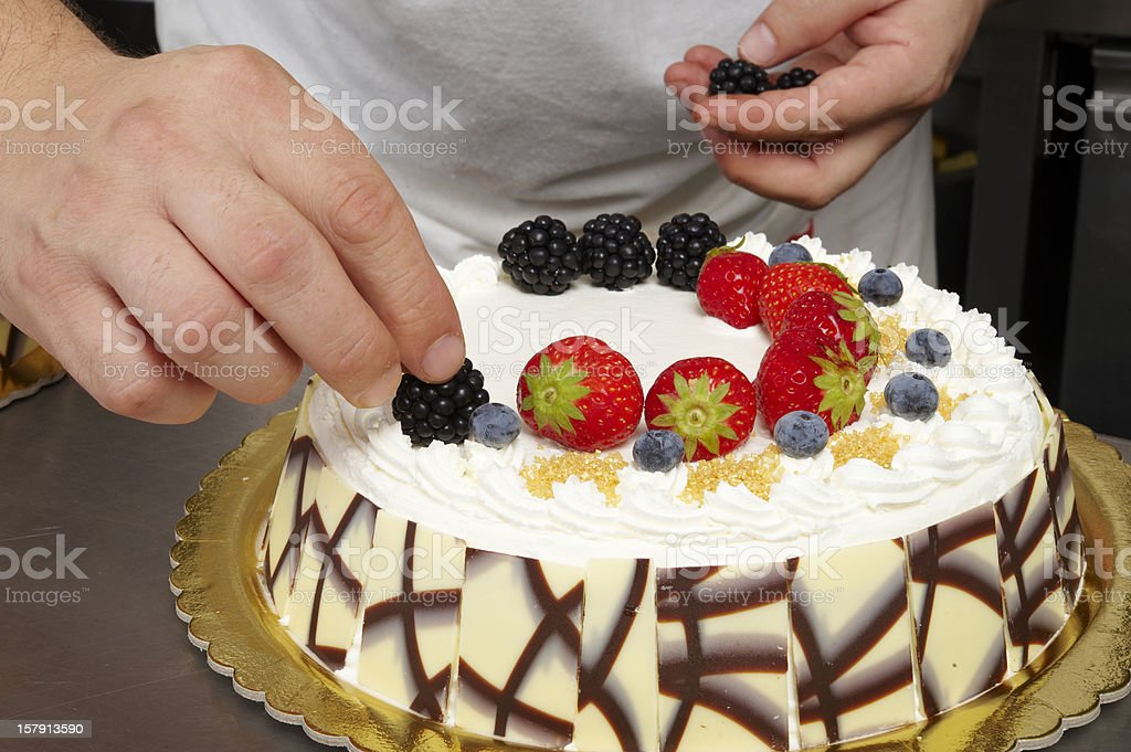 Decorating a Cake royalty-free stock photo