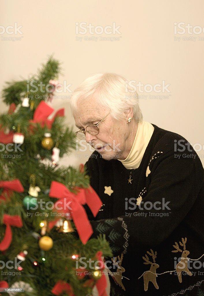 Decorating a Christmas Tree. royalty-free stock photo