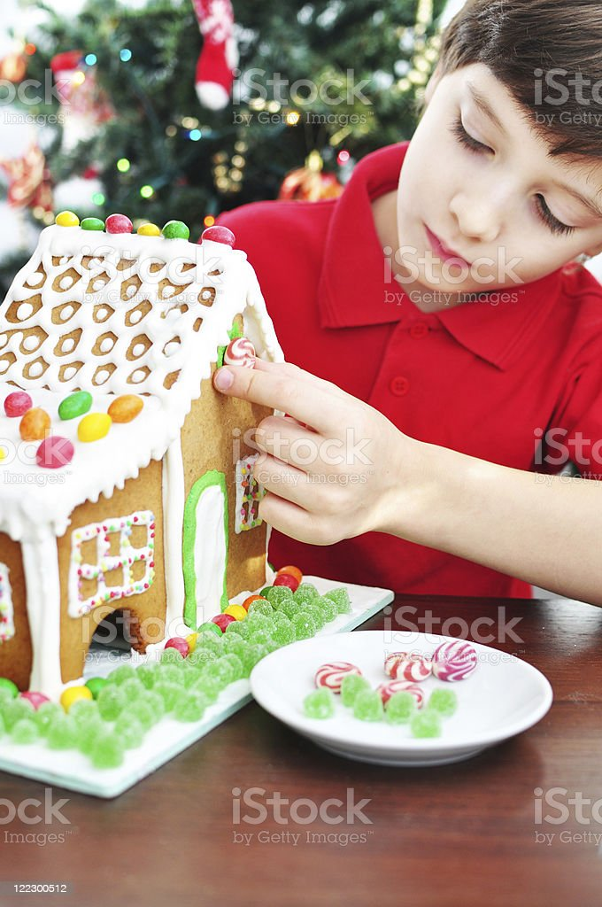 Decorating a Gingerbread House stock photo