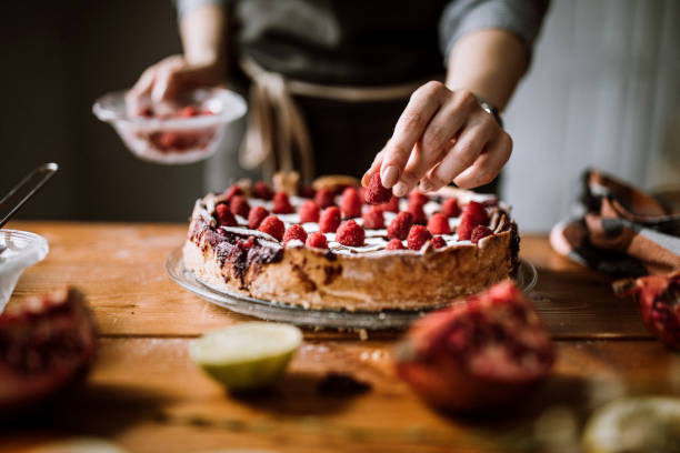 Decorating Blackberry Pie Using Fresh Fruits Young Woman Adding Finishing Decor Of Fresh Fruits To Delicious Blackberry Pie decorating a cake stock pictures, royalty-free photos & images
