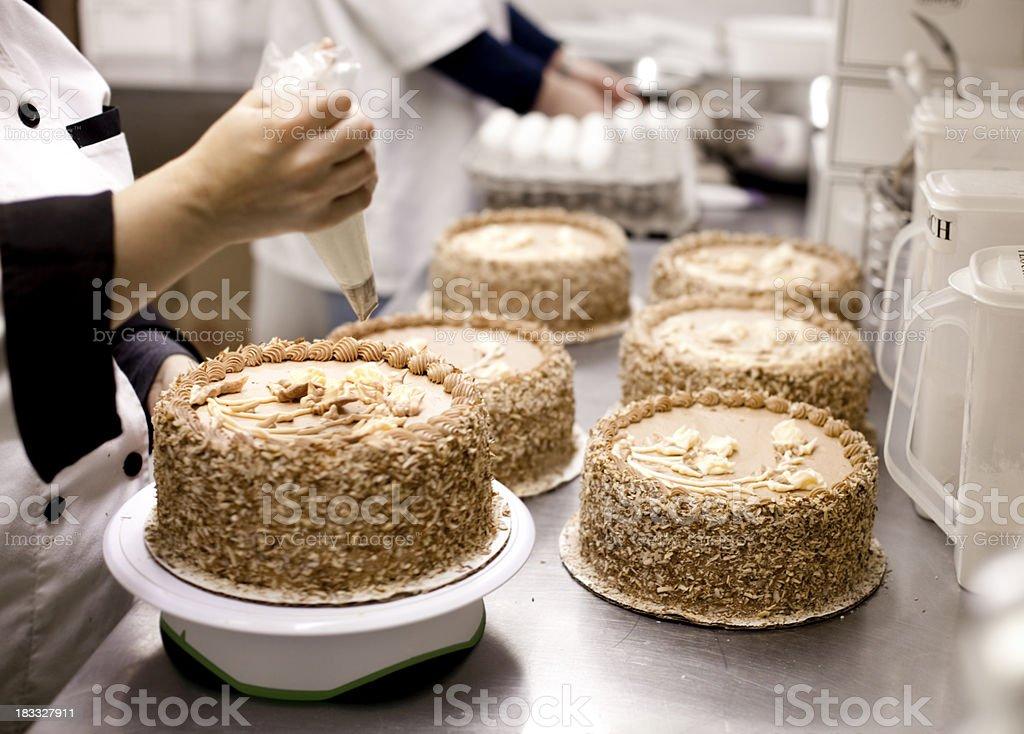 Decorating Cake royalty-free stock photo