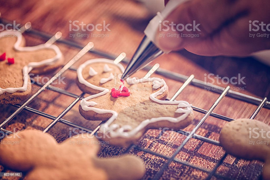 Decorating Christmas Cookies with Icing stock photo