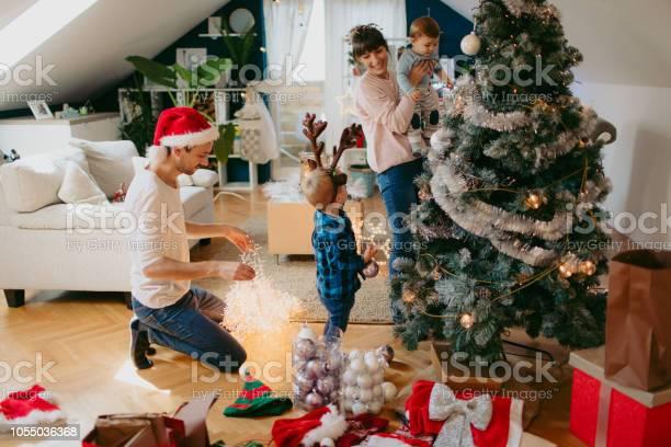 Decorating christmas tree picture id1055036368?b=1&k=6&m=1055036368&s=612x612&h=aeieiwdavjae8ruauzhm2nw0 nes1kql 5hawobf7ws=