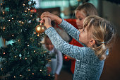 istock Decorating Christmas Tree with Ornaments and Christmas Lights 1054612438