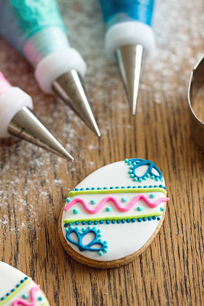 Decorating Easter cookies Easter cookies and piping bags for decorating icing bag stock pictures, royalty-free photos & images