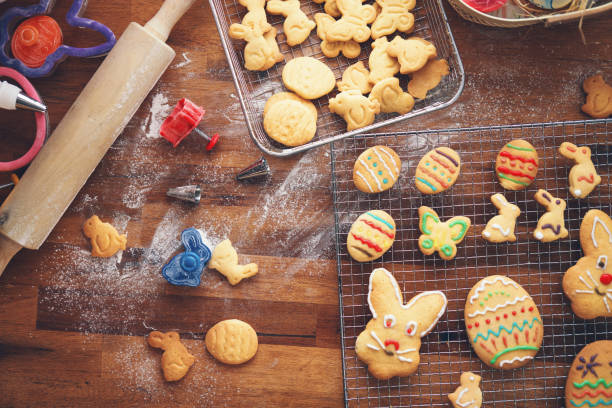 Decorating Easter Cookies with Colorful Icing stock photo
