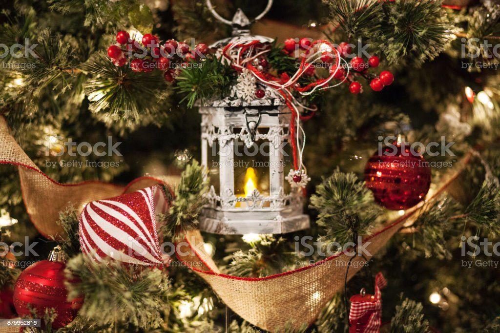 Decorating for Christmas - Candle And A Christmas Tree stock photo