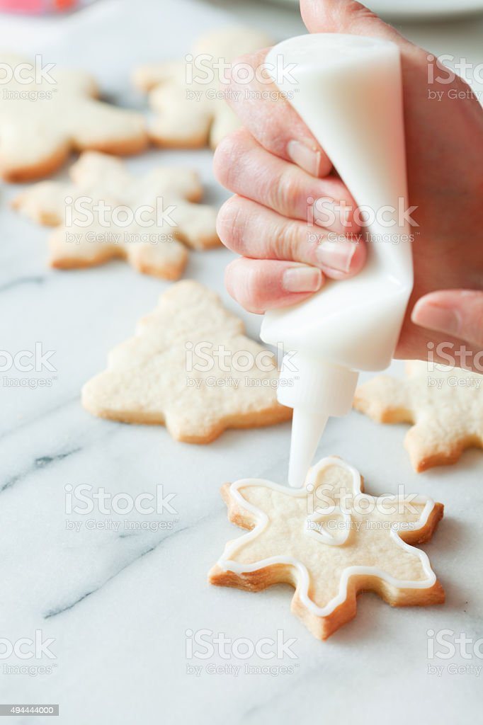 Decorating Snowflake Christmas Cookie With Frosting Stock Photo More Pictures Of 2015
