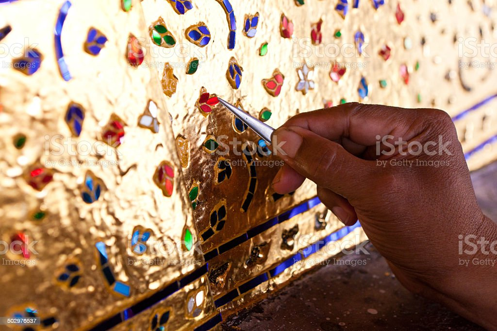 decorating the base of the image of Buddha with stained glass royalty-free stock photo