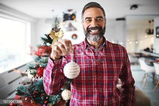 istock Decorating the Christmas tree. 1072047358
