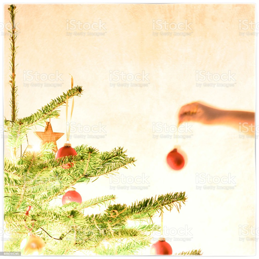 decorating the christmas tree stock photo