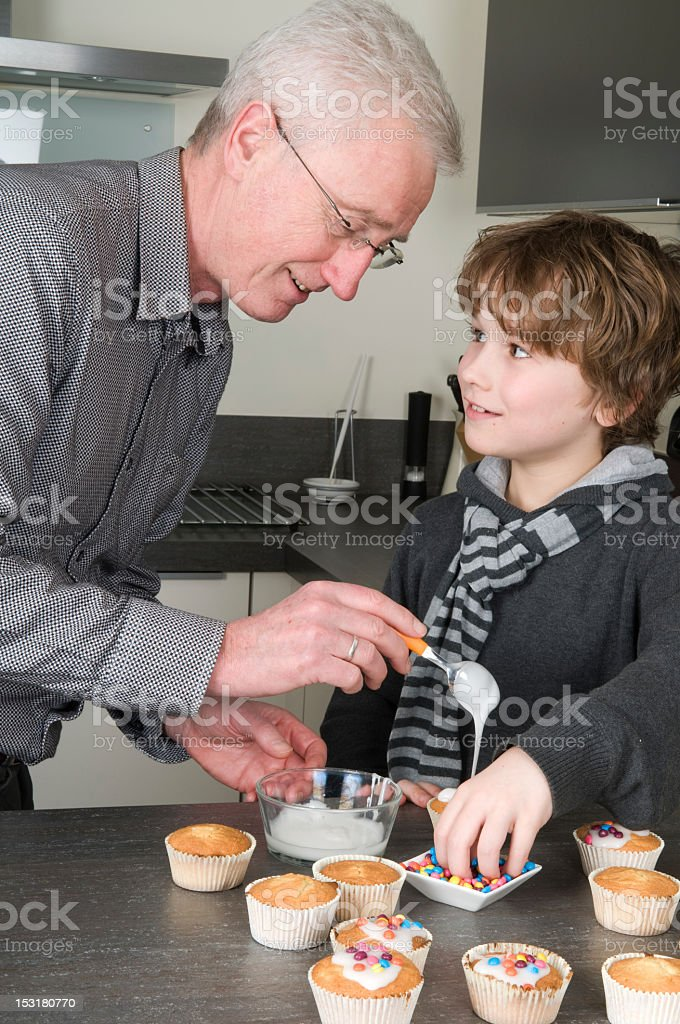 Decorating the cupcakes royalty-free stock photo