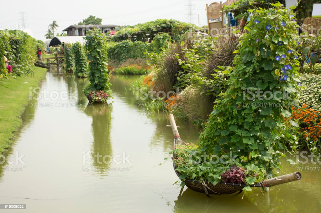 Decoration bamboo boat and tree plant in canal stock photo