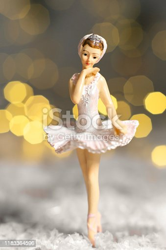 Decoration for the Christmas tree, a small figurine of a ballerina in a white tutu