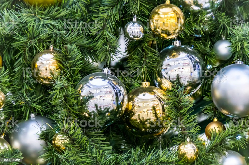 Decoration Hanging From A Christmas Tree Gold And Silver Balls Hanging On The Green Christmas Tree Closeup Stock Photo Download Image Now Istock