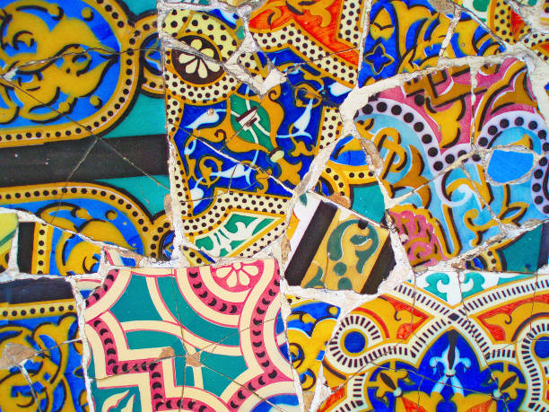 decoration in Park Guell, tile background broken glass mosaic,  Barcelona, Spain. Designed by Gaudi tile background broken glass mosaic,  Barcelona, Spain. Designed by Gaudi, decoration in Park Guel barcelona spain stock pictures, royalty-free photos & images