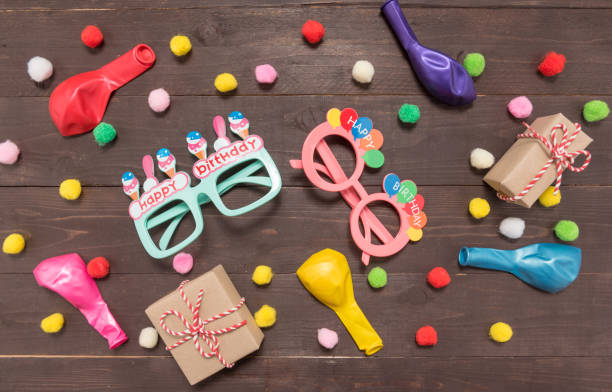 Decoration of Birthday party on the wooden background with empty space stock photo