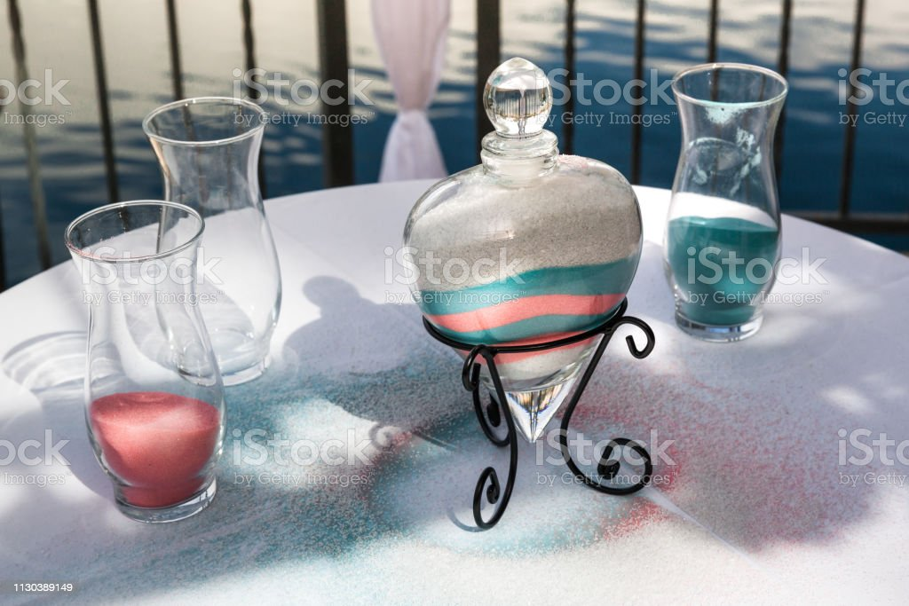Decoration Of Colorful Sand On The Table For Sand Ceremony On Wedding Day stock photo