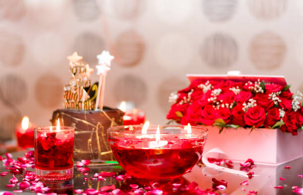Decoration of red flowers and candles for celebration Decoration of red flowers and candles for celebration. romance stock pictures, royalty-free photos & images