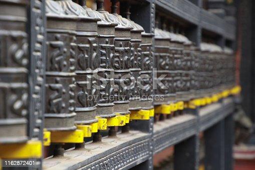 Decoration of Traditional Nepal Buddhist Prayer wheels at Kathmandu.Nepali word is prayer word in buddhism