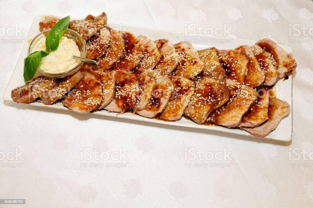 Decoration roasted pork with savory sauce stock photo