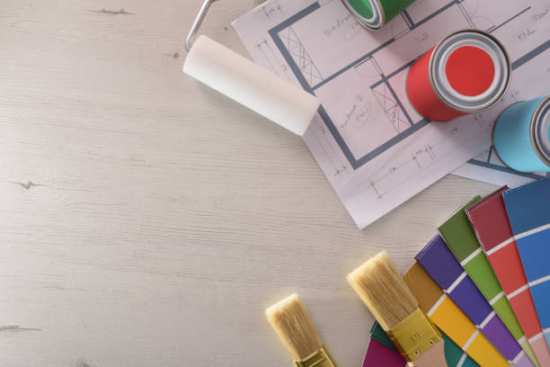 Decoration table and painter with plane and painting material background Decoration table and painter with plane and painting material. Top view. Horizontal composition. public housing stock pictures, royalty-free photos & images