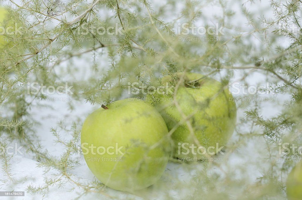 Decoration with green apples and asparagus on white background royalty-free stock photo
