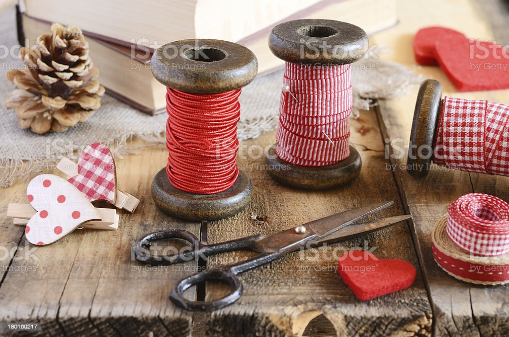 Decoration with wooden spools and red ribbons royalty-free stock photo