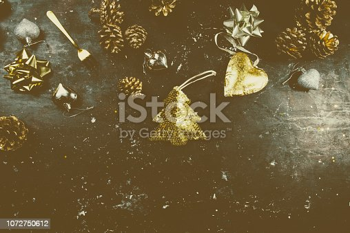 istock Decorations of christmas on a red board 1072750612
