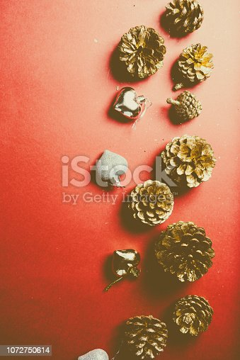 istock Decorations of christmas on a red board 1072750614