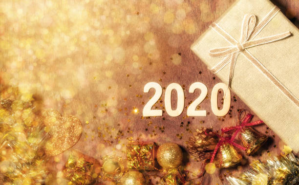 decorations of happy new year 2020 festival with copy space for your text beside. - gradients golden ribbons imagens e fotografias de stock