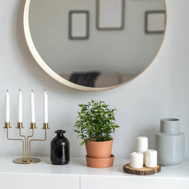 Decorative accessories on white sideboard stock photo