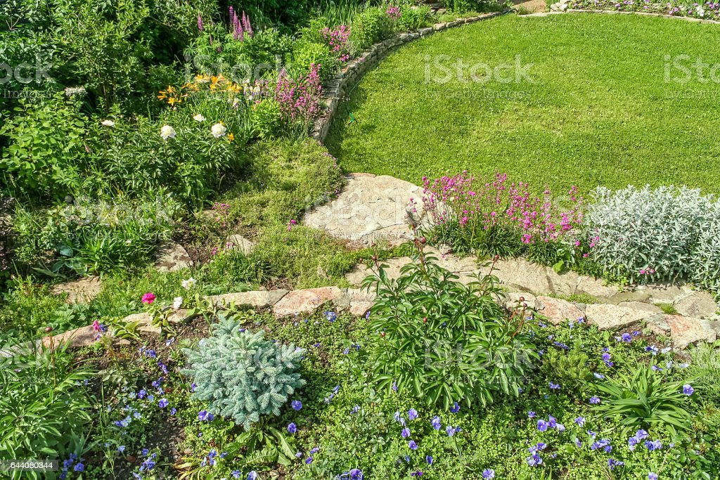 Decorative alpine slide and green lawn stock photo
