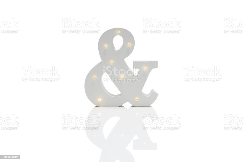 Decorative Ampersand with Embedded LED Lights Over White Background stock photo