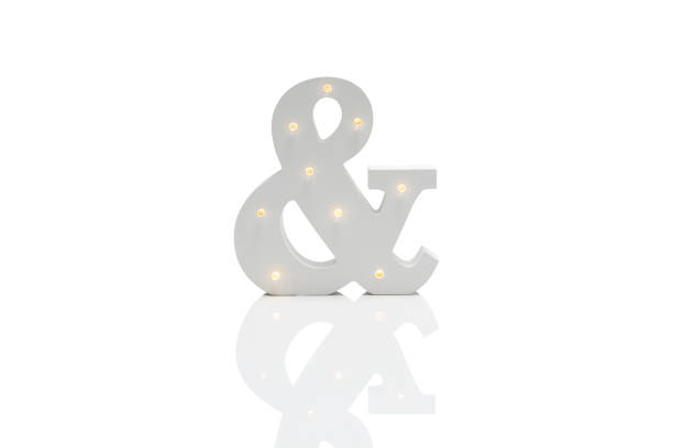 decorative ampersand with embedded led lights over white background - ampersand stock pictures, royalty-free photos & images