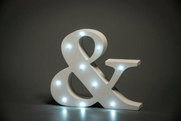decorative ampersand with embedded led lights - ampersand stock pictures, royalty-free photos & images