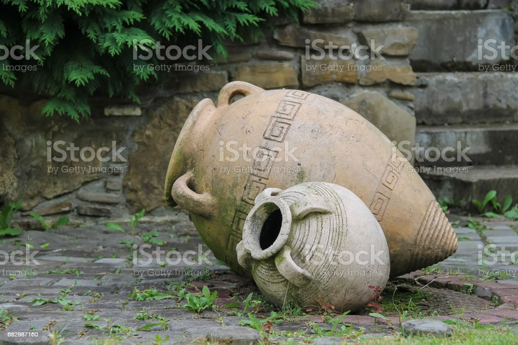 Decorative amphora in the garden - Photo
