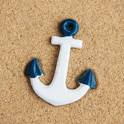 istock Decorative anchor on a sand 994751232