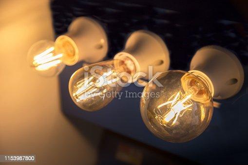 940992564 istock photo Decorative antique edison style light bulbs against. 1153987800