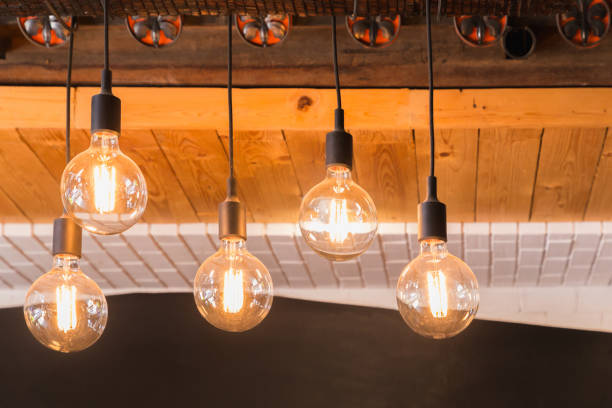 Decorative antique LED tungsten light bulbs hanging on ceiling. - foto stock
