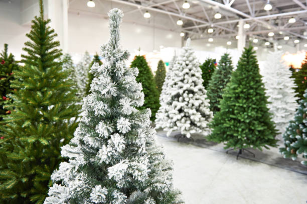 Decorative artificial christmas trees in store Decorative artificial christmas trees in the store imitation stock pictures, royalty-free photos & images