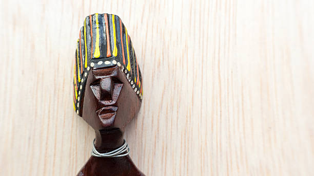 Decorative Asian or African tribal totem carved from forest wood stock photo