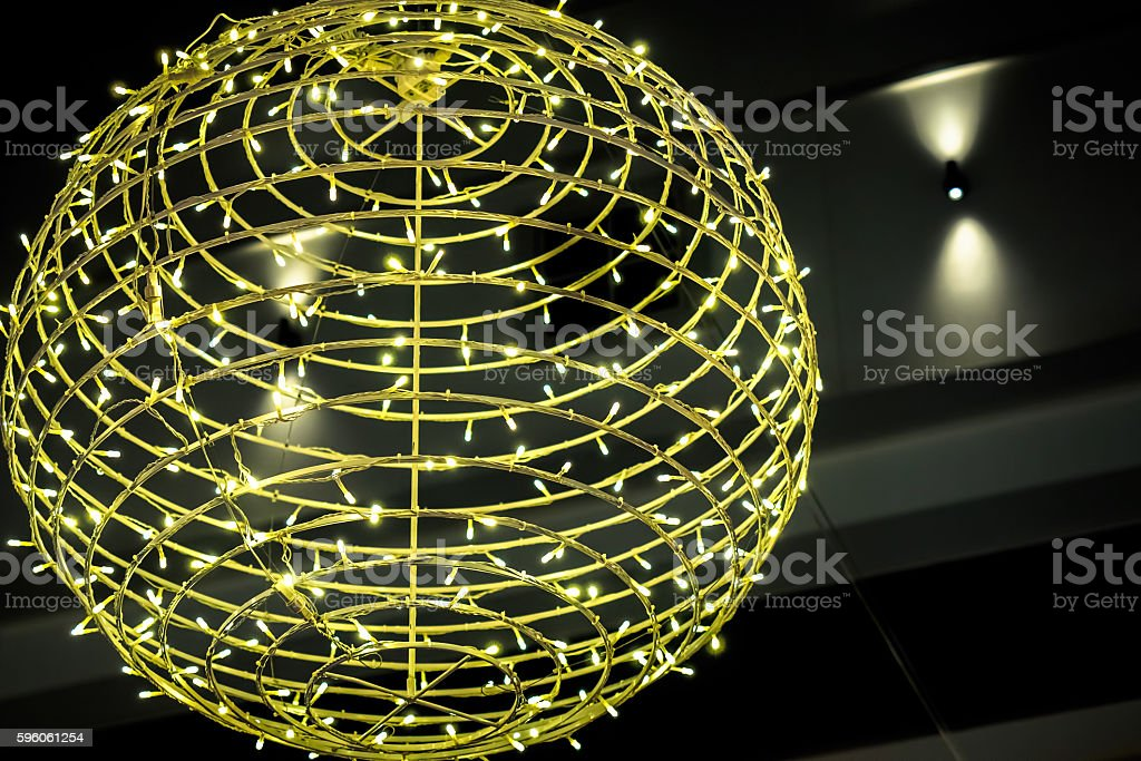 Decorative ball wound with Christmas lights royalty-free stock photo