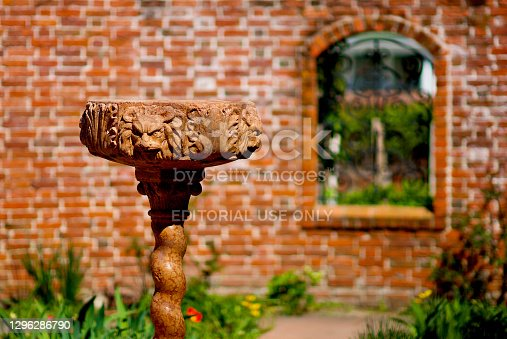 New Bern, North Carolina / USA - April 1, 2017: A decorative birdbath stands out in the middle of a formal garden on the grounds of historic Tryon Palace.