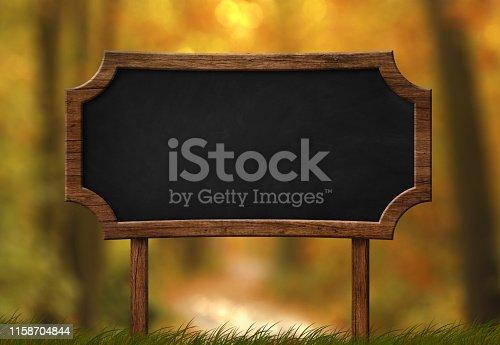 istock Decorative blackboard signboard autumn forest background 1158704844